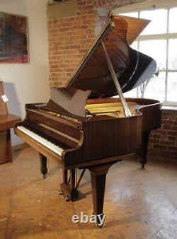 A 1975, Steinway Model O grand piano with a mahogany case. 3 year warranty