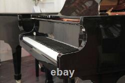 A 2005, Wendl and Lung Model 178 grand piano in black. 3 year warranty