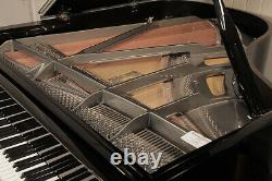 A 2010, Feurich Model 178 grand piano with a black case and gun metal frame