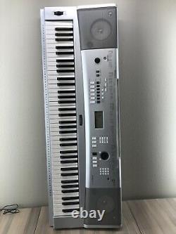 Yamaha Portable Grand Piano Keyboard Model DGX-230