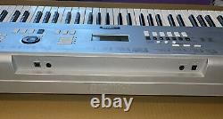 Yamaha Portable Grand Piano Keyboard Model DGX-230 Piano-focused 76-keys